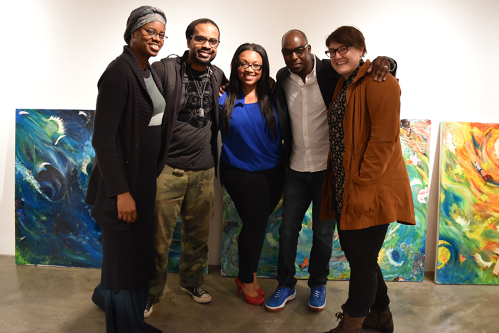 """Art and Social Engagement"" participants pose with a mural created for Solomon's Temple."