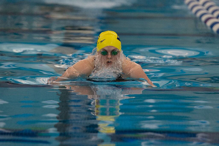 woman swimmer competes in breaststroke