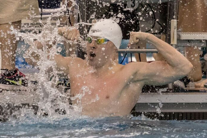 male swimmer flexes muscles