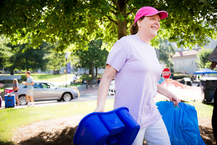 Emory Provost Claire Sterk steps in to help move students into Emory residence halls.