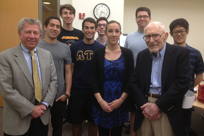 Claude Sitton returned to Emory to teach from 1991 to 1994 and later served as a guest speaker in journalism classes. Here, he poses with Professor Hank Klibanoff and students in Klibanoff¿s 2013 freshman seminar on news coverage of race.