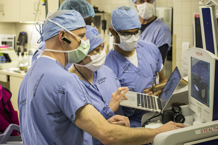 Neurosurgeon Robert Gross (foreground, with earpiece) conducts a majority of the deep brain stimulation surgeries performed at Emory.
