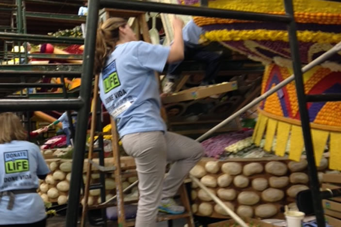Dr. Nicole Turgeon hard at work decorating the Donate Life float.