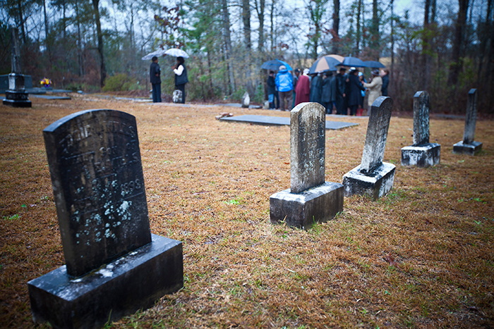 Relatives of others who had voted on that fateful day in 1948 joined Isaiah Nixon's family and Emory students for the Jan. 22 visit to the gravesite.