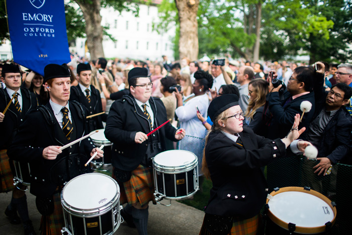 Drums lead the procession into the university-wide Commencement ceremony.