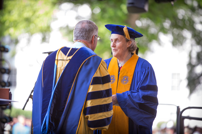 President Wagner congratulates Colorado State University professor Temple Grandin as she receives an honorary degree for her contributions as an autism advocate and expert on animal behavior.