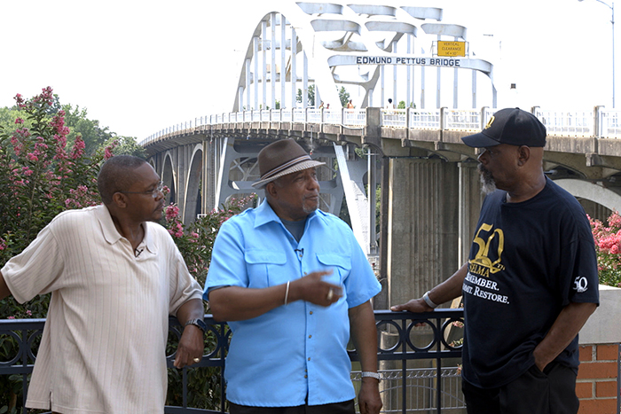 LaFayette (center) talks with two Selma, Alabama, residents at the foot of the Edmund Pettus Bridge.