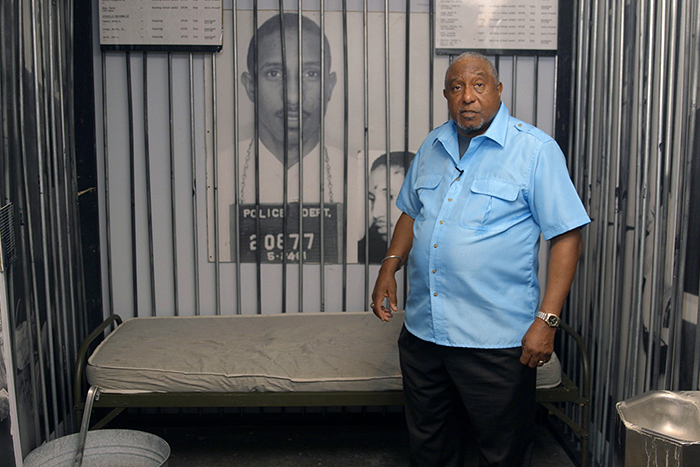 LaFayette tells a story from an exhibit in the National Voting Rights Museum and Institute in Selma that has been recreated to look like the cell in which he was imprisoned.