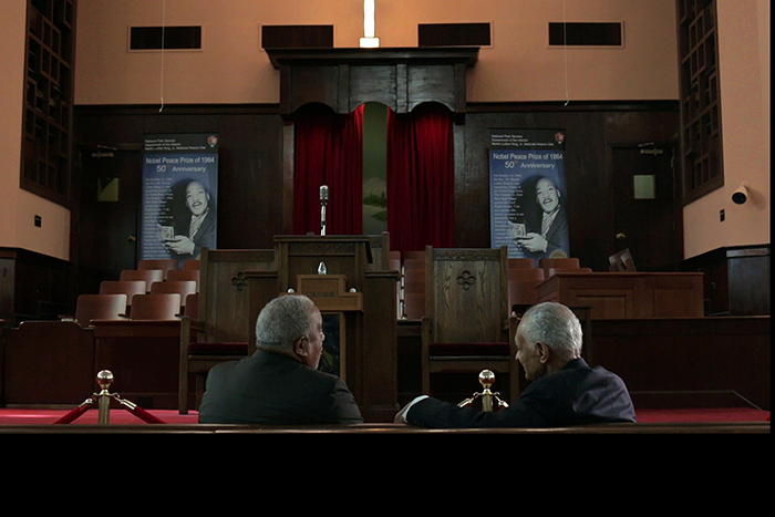 LaFayette (left) talks with fellow civil rights activist Rev. C.T. Vivian at the historic Ebenezer Baptist Church on Auburn Avenue during a filming for the course.