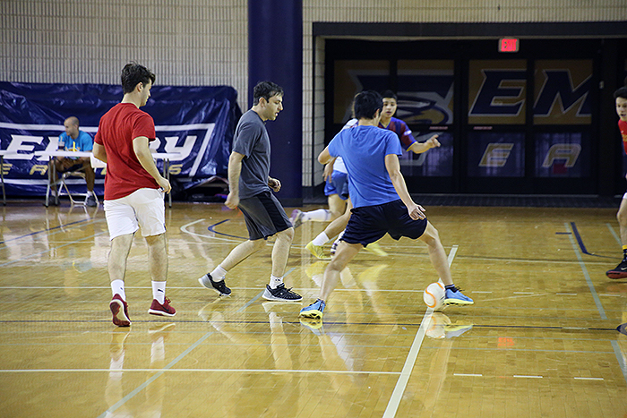 people playing soccer indoors