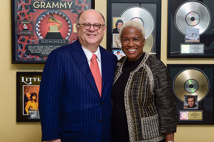 Joel Katz poses with former Atlanta television anchor Monica Person at the opening of the Joel A. Katz Music is Medicine Collection.