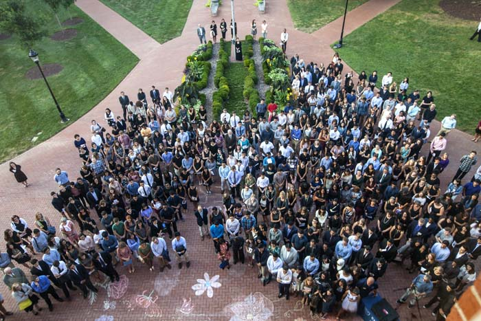 """""""Let us pass in the light that Abinta and Faraaz left behind. In remembering them, we remember what evokes our deepest humanity,"""" Emory President-elect Claire Sterk told the crowd gathered near the steps of Oxford's Seney Hall."""
