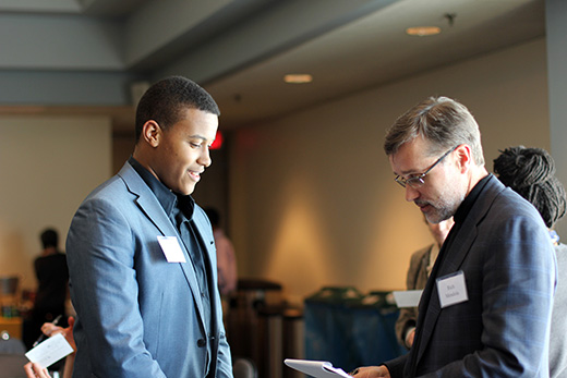 Retreat participants were divided into working groups. Here, student David Watkins talks with Rich Mendola, enterprise CIO and senior vice provost for library services and digital scholarship.