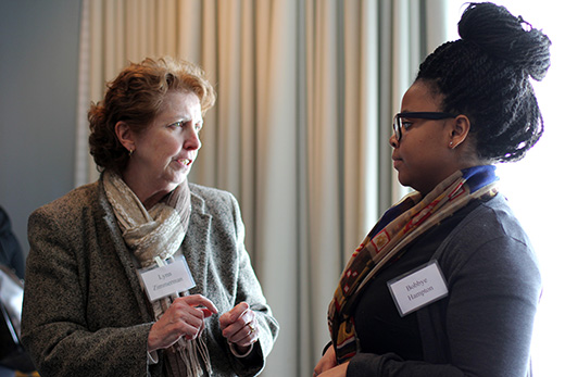Student Bobbye Hampton converses with Lynn Zimmerman, senior vice provost of academic affairs.