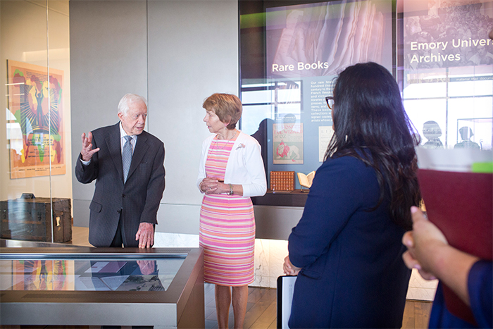 jimmy carter and rosemary mcgee look at displays