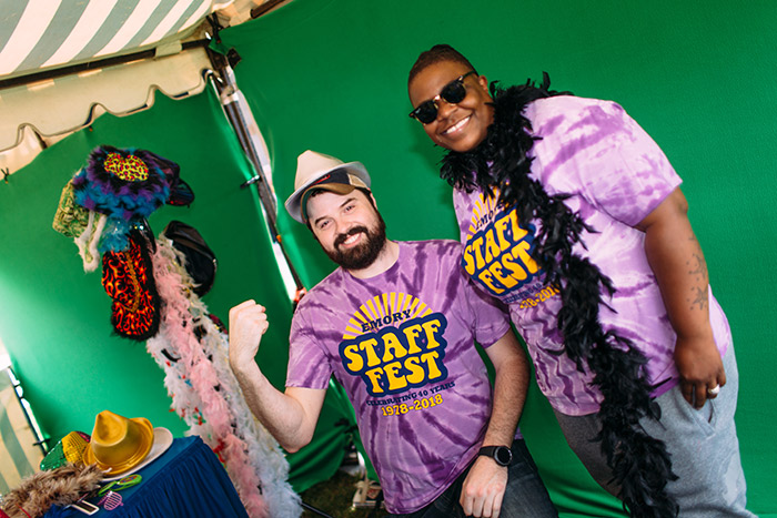Staff members pose in a photo booth in Staff Fest t-shirts