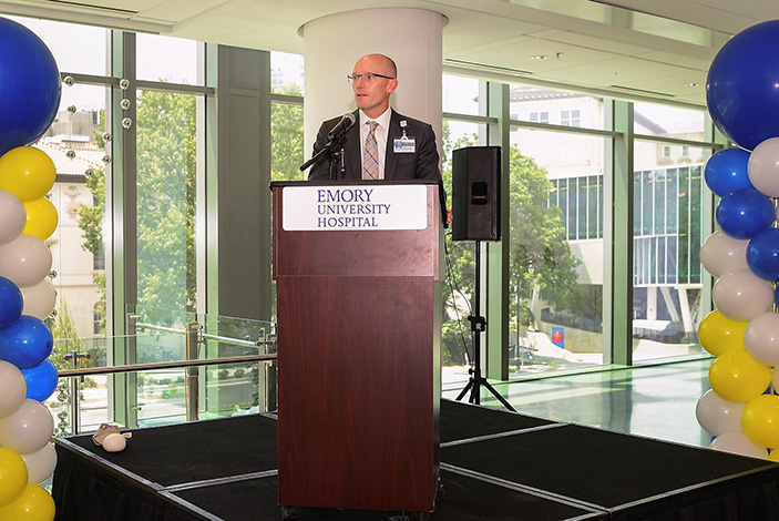 Bryce Gartland, CEO of Emory University Hospital, welcomes a room full of staff to the EUH Tower Open House.