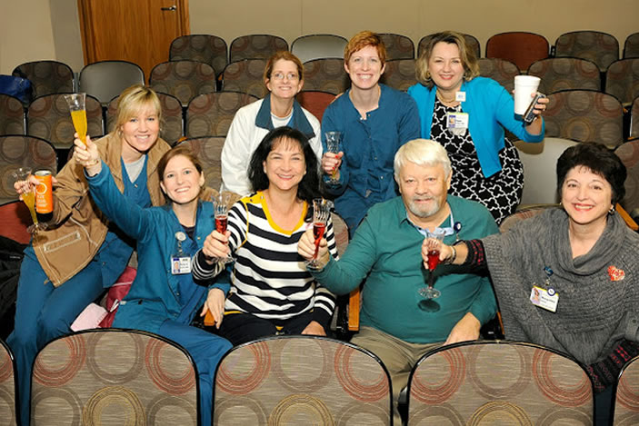 Emory Healthcare staff share a non-alcoholic toast in celebration.
