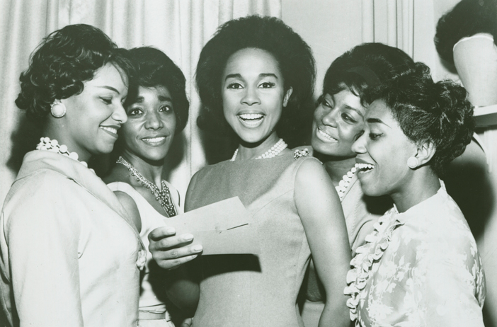 Diahann Carroll (center), pictured with charm school students in this undated photo, started her career as a Grace del Marco model. Credit: Ophelia DeVore papers, MARBL, Emory University.