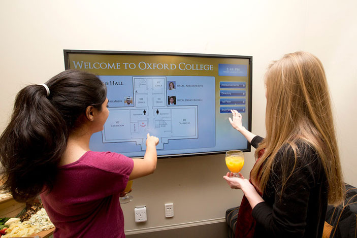 In the first-floor entry, a flat-screen monitor provides visitors with building and campus directories with touch technology.