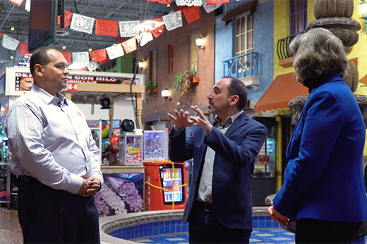 "Julio Penaranda (left), general manager of Atlanta's Plaza Fiesta shopping center, speaks with Emory professors Pablo Palomino (center) and Vialla Hartfield-Mendez in a video interview included in the ""Making Progress"" Teach-Out."