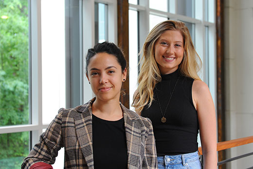 Clara Perez (left) and Katya Bobrek are among six recent Emory College graduates to earn prestigious graduate research fellowships from the National Science Foundation. Photo by Becky Stein.