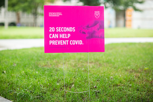 Signs on Emory campus about COVID-19 safety measures