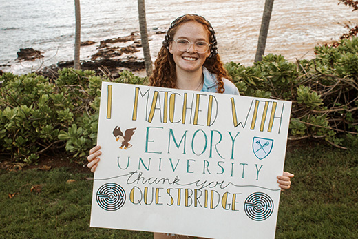 Newly admitted Emory students holds sign